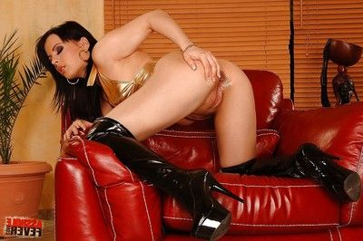 Brunette hair dear in latex boots oils up and sex toy has intercourse her anal opening