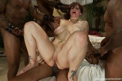 Rounded redhead in intense interracial orgy with creampie