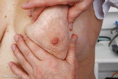 Seasoned fatty with bushy twat receiving enema from gyno doctor
