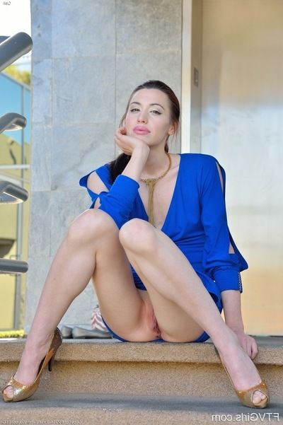 Small dark brown broad in a blue clothing divulges her cleanly shiny on top cage of love