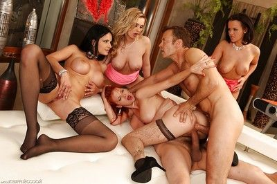 Astonishingly moist pornstars take part in a groupsex with 2 well-hung dick-holders