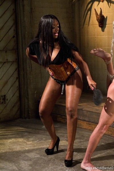 Marvelous brown domme tramples and smothers alluring slaveboy