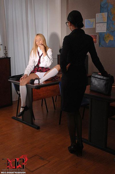 Glasses wearing dyke educator catches schoolgirl fucking and compresses Fetish copulation