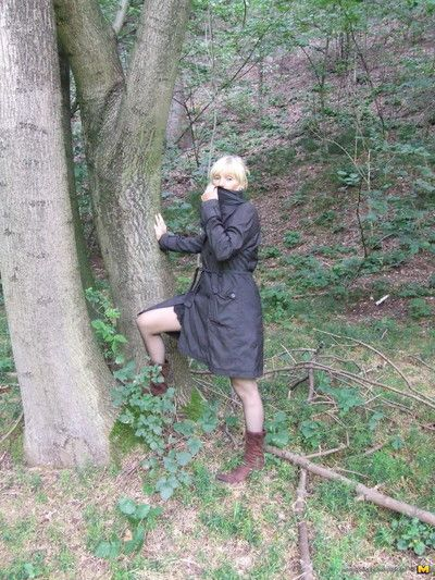 Blond placid bitch playing nude in the forest