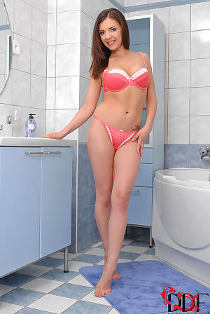 Awesome and petite chick with dark hair is masturbating with big toy in the bathroom