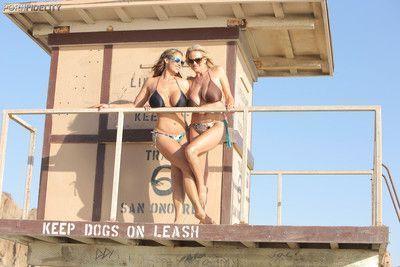 Busty beach threesome of hot swinging couple