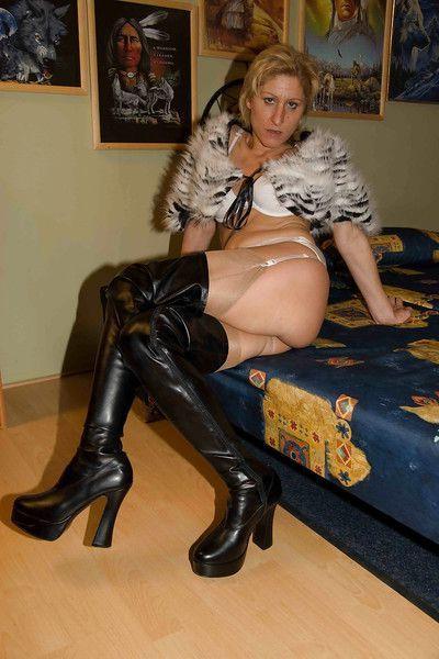 Hot mature amateur Silke Mausz gets butt fucked wearing boots in group sex