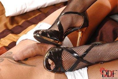 Crazy bald slut C.J. in hot stockings presents awesome footjob