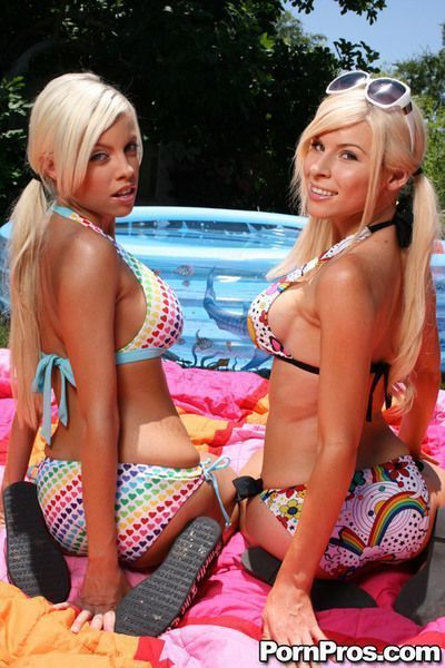 Young babes with big tits Kenzi and Britney posing outdoor in the pool