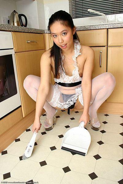 Stocking and uniform clad Chinese 1st timer widening  uterus in kitchen