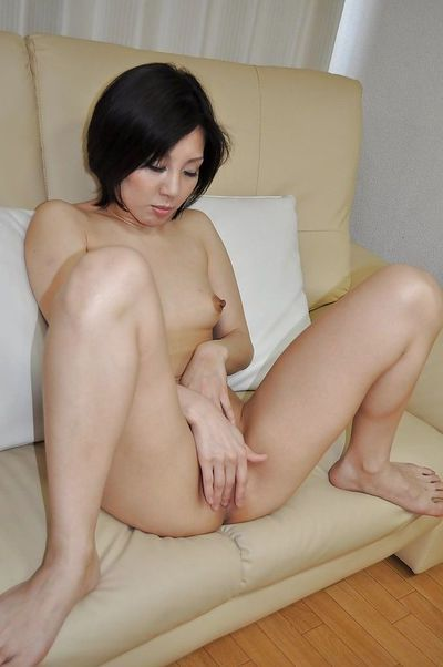 Beautiful Japanese MILF Mayumi Iihara undressing and jerking off her muff