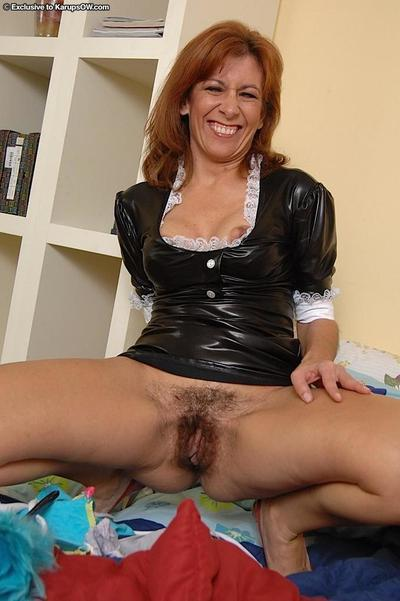 Sassy mature maid taking off her panties and exposing her bushy gash
