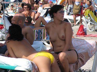 Candid beach fresh chicks  beach voyeur photos topless sunbathing