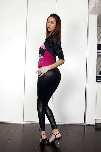 Pretty European cutie Kitty Jane strutting non unclothed in leather underwear