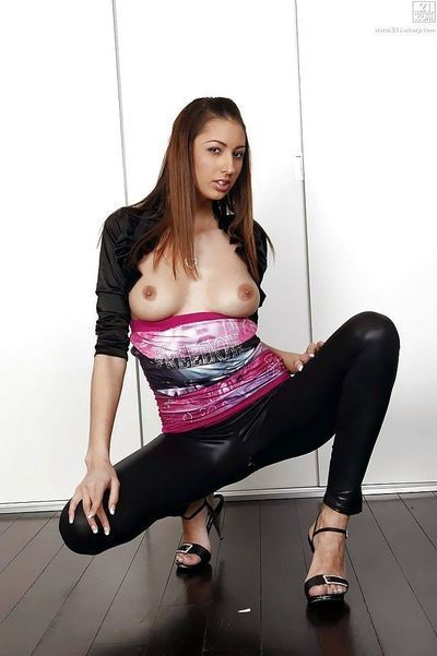 Pretty European cutie Kitty Jane strutting non unclothed in leather underwear