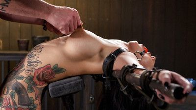 Tattooed fetish model Lily Lane taking hardcore nipple torture abuse
