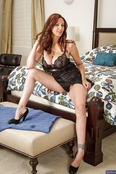 Milf Julia Ann takes off her luxury underware right in the bedroom