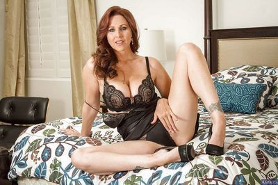 Milf Julia Ann takes off her luxury underware right in the bedroom
