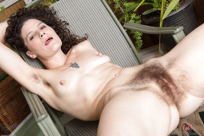 Mature hirsute model Sunshine baring tits and hairy underarms