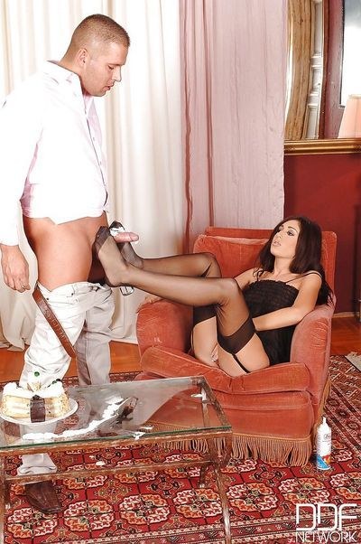 Brunette chick Eloa Lombard uses her nylon attired feet to jerk off cock