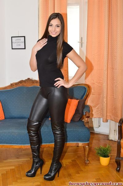 Amateur female Lara Latex flashes her boobs before pulling down her pants