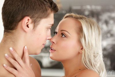 Blonde teen Naomi Nevena shows off small breasts before taking cumshot