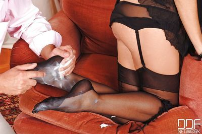 Hot brunette chick Eloa Lombard giving footjob with nylon encased feet