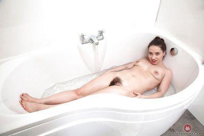 Petite European MILF Olga Cabaeva revealing hairy pussy in bathtub