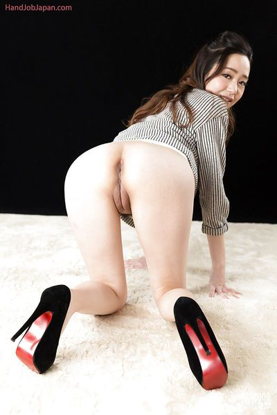 Asian girl in heels spreads legs to show Japanese pussy lips before eating cum