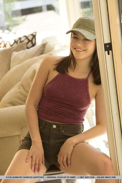 Ten cutie in cap Kylie Quinn undressing her well toned assets