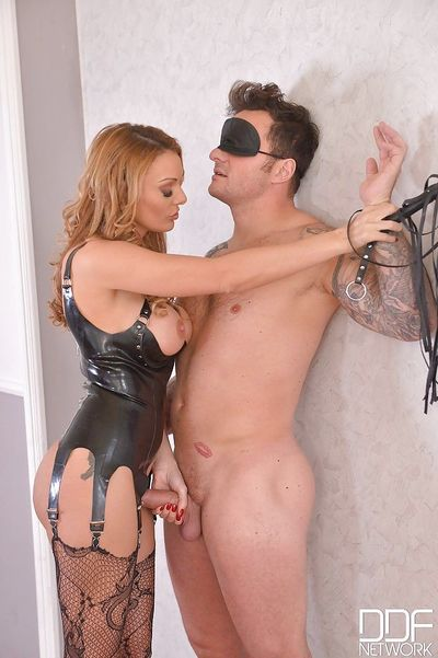 Hot femdom action with busty domme Stacey Saran supplying discipline to man