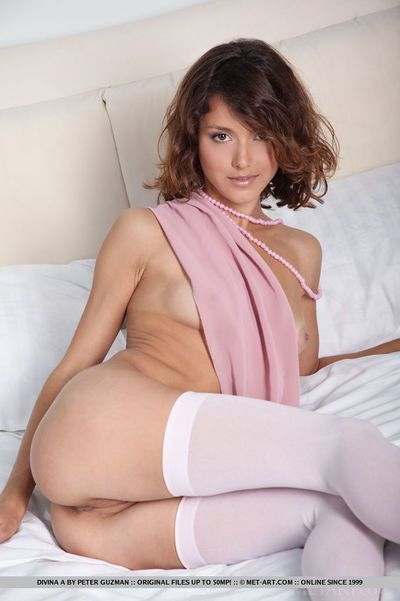 Erotic model Divina A flaunting perky tits & spreading pussy in stockings