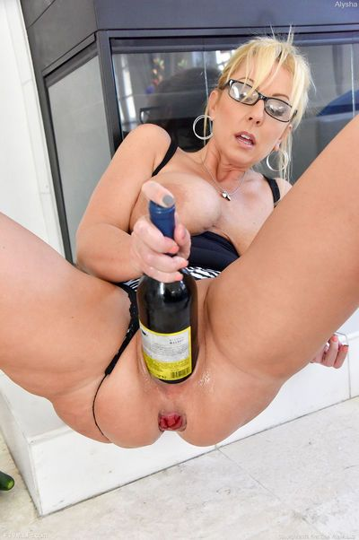 Big boobed blonde MILF inserts huge toys and a bottle into her wide open pussy