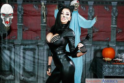 Brunette beauty Audrey Bitoni posing in cat woman garb and makeup