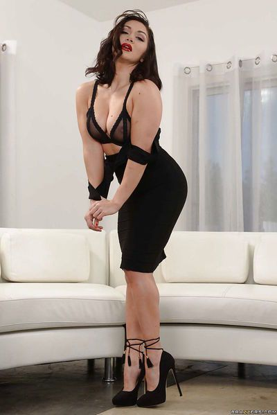 Brunette solo model Lea Lexis removing black dress to model in underthings
