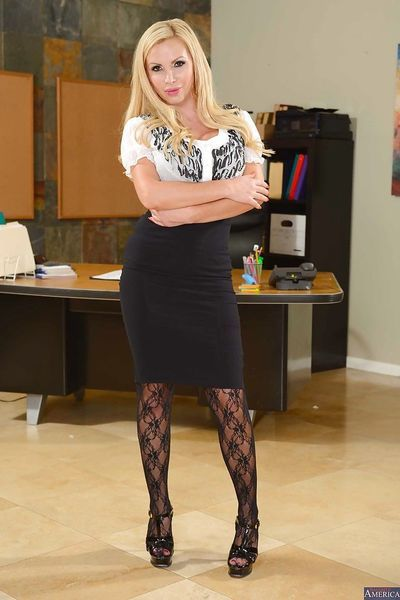 Office blonde Nikki Benz touches her lovely shaved pussy as she like!