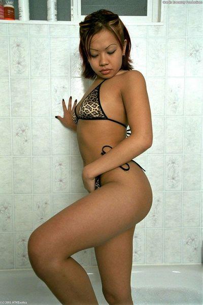 Asian first timer Gia taking off her wet bikini in bathtub