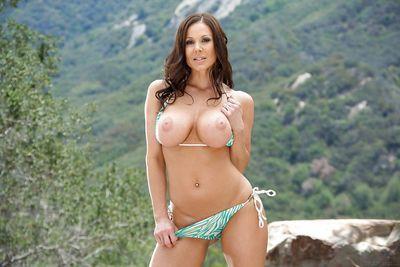 Buxom brunette mom Kendra Lust flashing her big knockers outdoors
