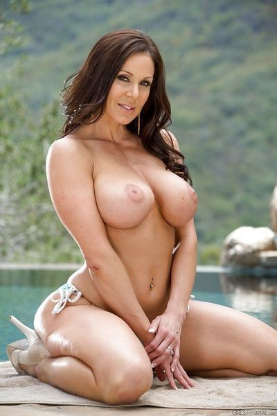 Buxom brunette mom Kendra Lust flashing her big knockers outdoors