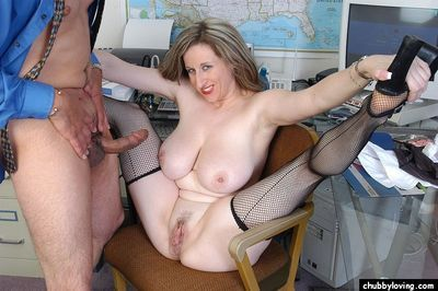 Older broad Kitty having sex with co-worker in office wearing mesh stockings
