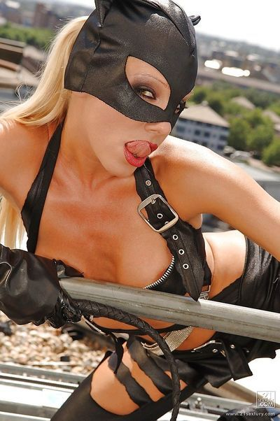 Stupendous pornstar in catwoman outfit performs a milky strip scene