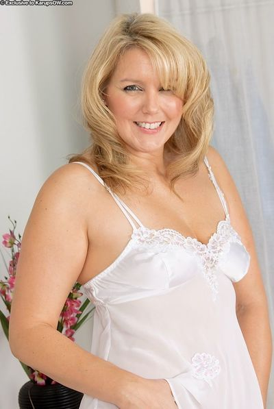 Chunky mature blonde Amarillo slips off satin lingerie and plays with her twat