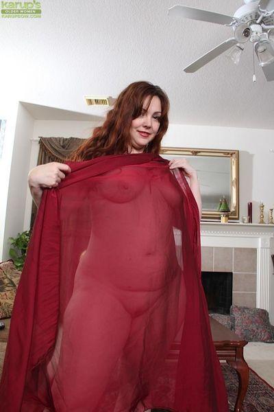 Busty redhead fatty Ember Rayne spreads hairy MILF pussy for masturbation