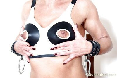 Kinky European woman Lady Sarah posing in nippleless bra and handcuffs