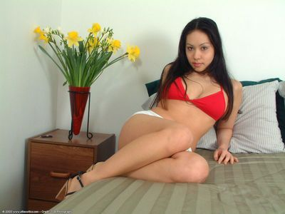 Pretty Asian amateur Milla unveils tight ass and trimmed muff under shorts