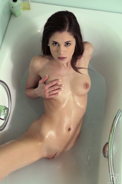 Brunette caprice indulges in some wet and wild fun in the bathtu