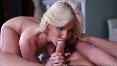 Milf blonde Phoenix Marie deepthroats and gives a nice footjob