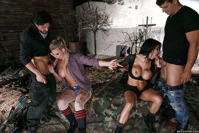 Big boobed pornstars Peta Jensen and Phoenix Marie blow big cock outdoors