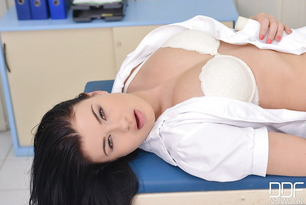 Gorgeous babe Lucy takes a uniform of a nurse and masturbates with a dildo