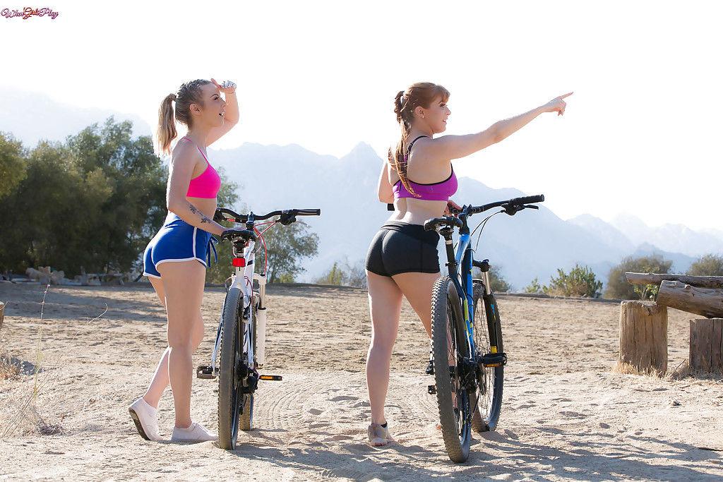 Pornstars Karla Kush and Penny Pax shedding cycling clothing before lesbo sex
